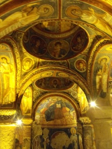 Inside a cave church.. beautiful paintings.