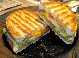 A bacon, avocado, tomato, cheddar, and black pepper on Toscano bread Panini!! :)