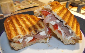 Deliciously grilled mozzarella, proscuito, and tomato on Toscano bread Panini!! :)