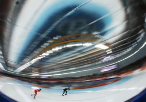 Denny Morrison (R) skates during the 1500m long track speed skating race in the Adler Arena in Sochi, Russia.