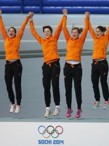 Gold medalists from the Netherlands celebrate their victory in speed skating ladies' tam pursuit.