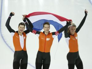 Sven Kramer, left, Jan Blokhuijsen, centre, and Koen Verweij of the Netherlands celebrate their gold medal in speed skating men`s team pursuit.