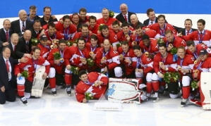 SOCHI, RUSSIA - FEBRUARY 23:  The Canadian team pose with the gold medals won during the Men's Ice Hockey Gold Medal match against Sweden at Bolshoy Ice Dome on February 23, 2014 in Sochi, Russia.