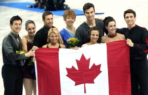 Canada's figure skaters stepped onto an Olympic podium as a group, winning the silver medal in the inaugural team event at the Sochi Olympics.