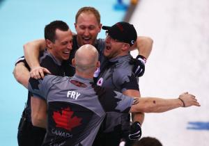 EJ Harnden, Brad Jacobs, Ryan Fry and Ryan Harnden of Canada celebrate as they win gold during the Men's Gold Medal match.