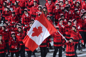 Canada's flag bearer, ice hockey player Hayley Wickenheiser leads the national delegation during the Opening Ceremony of the Sochi Winter.