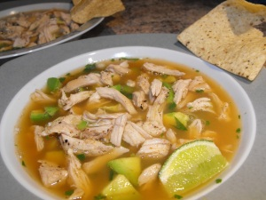Chicken, Avocado & Chipotle Soup with Limes and Tortilla Chips on the side... Yummy!