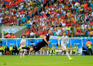 Netherlands' Robin van Persie scores a goal during the group B World Cup soccer match between Spain and the Netherlands at the Arena Ponte Nova in Salvador.